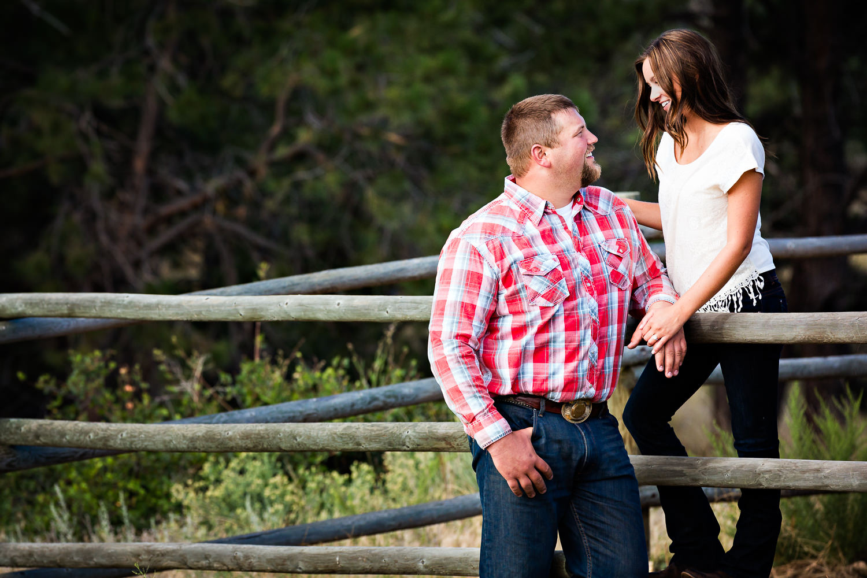 billings-montana-engagement-session-couple-leans-against-fence.jpg