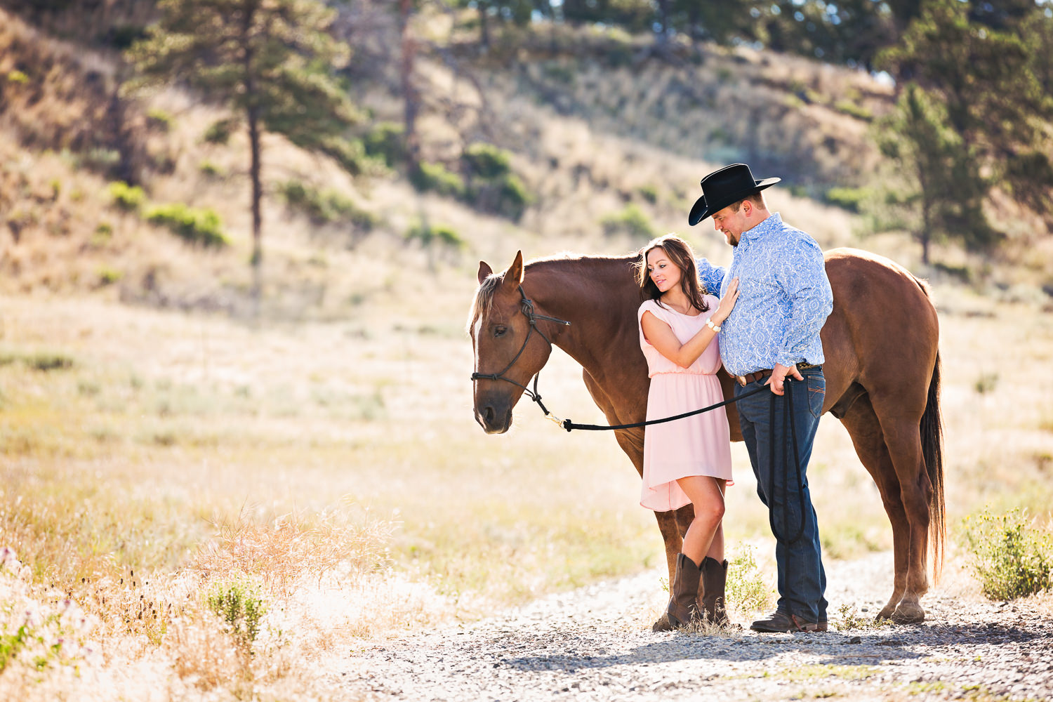 billings-montana-engagement-session-couple-look-at-horse.jpg