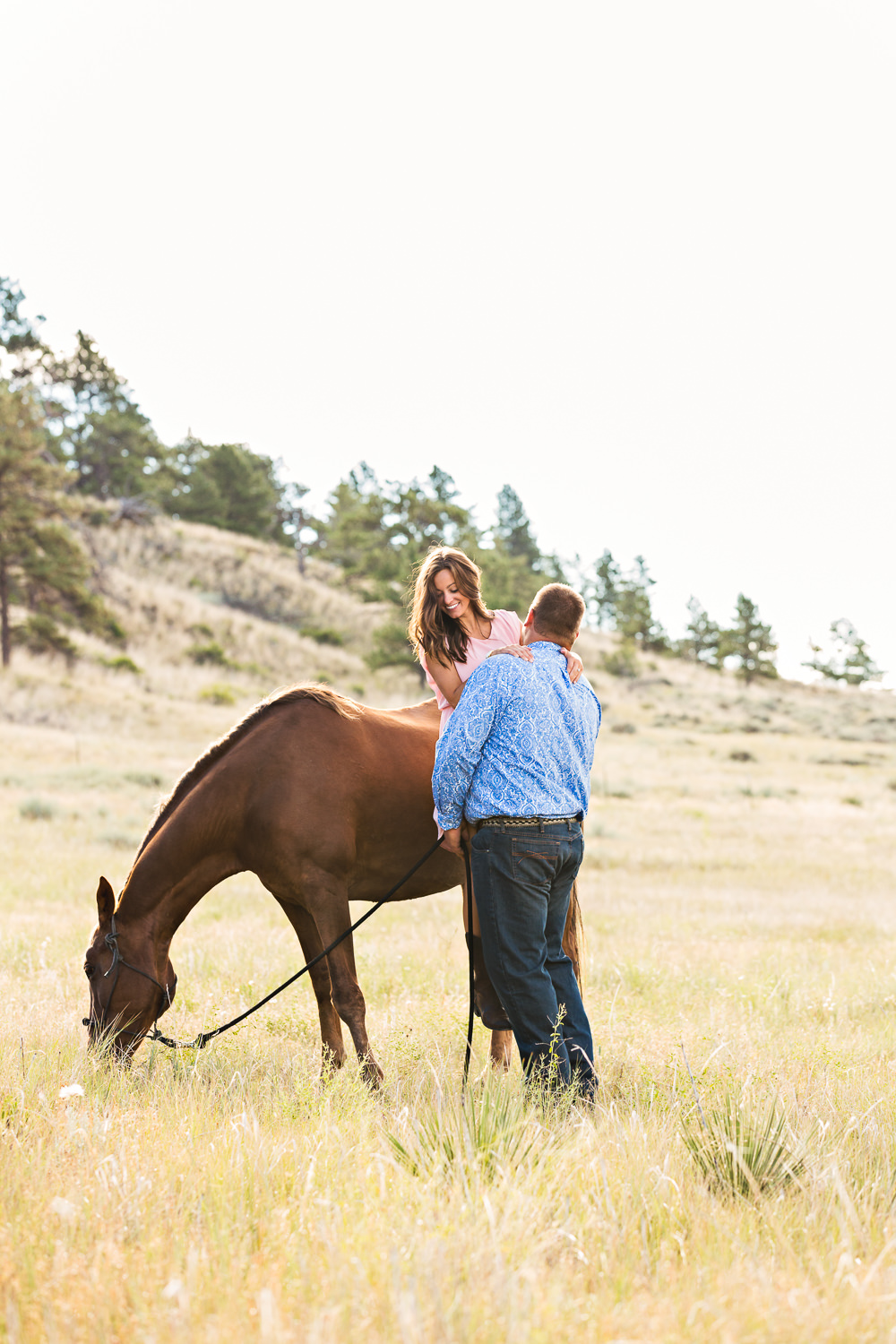 billings-montana-engagement-session-man-helps-woman-off-horse.jpg