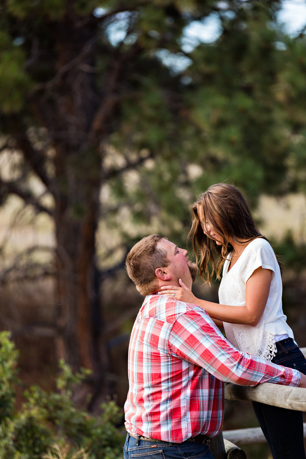 billings-montana-engagement-session-woman-leans-against-man-on-fence.jpg