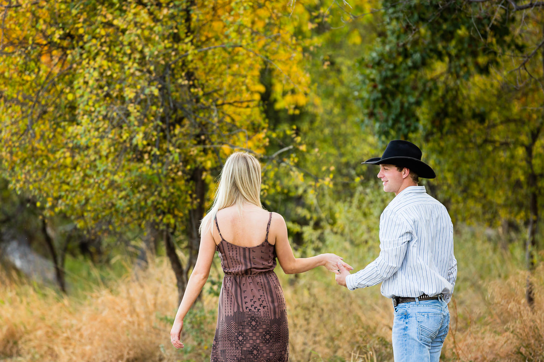 Billings-Montana-fall-engagement-couple-walking-through-park.jpg