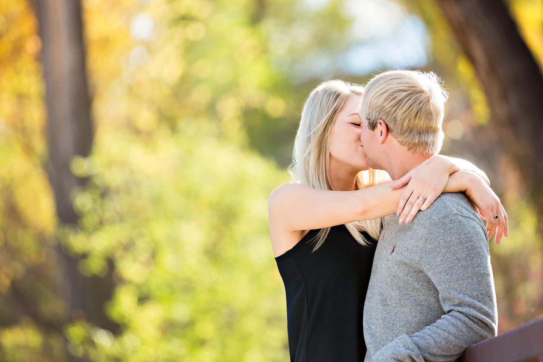 Billings-Montana-fall-engagement-kissing-in-colorful-park.jpg