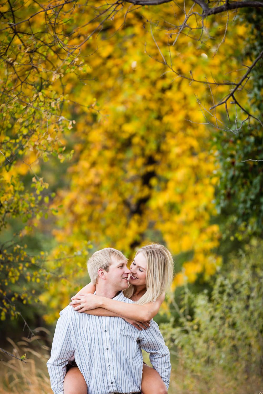 Billings-Montana-fall-engagement-playful-piggyback-ride.jpg