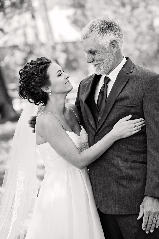 billings-montana-swift-river-ranch-wedding-father-daughter-first-look-hug.jpg