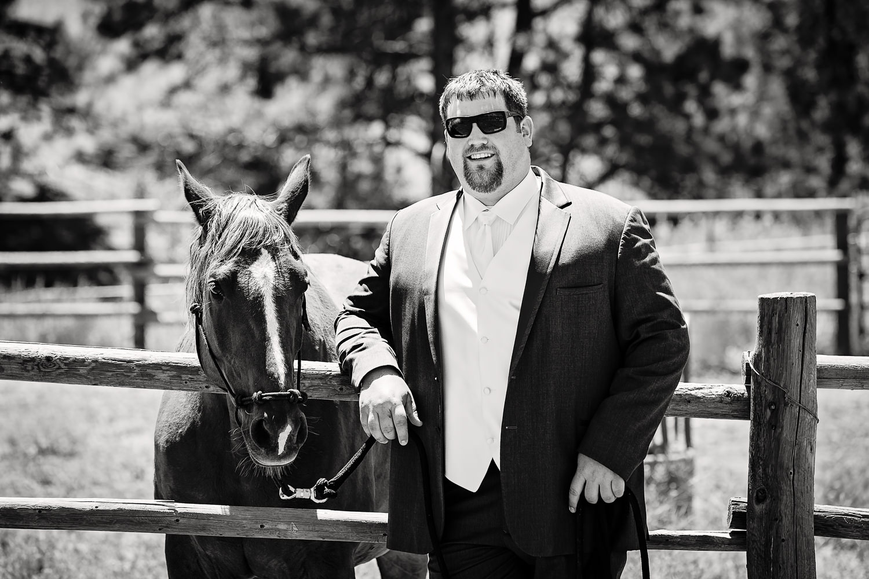 billings-montana-swift-river-ranch-wedding-groom-with-his-horse.jpg