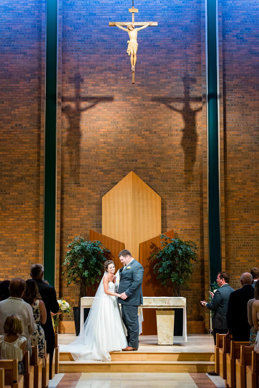 billings-montana-swift-st-thomas-ceremony-bride-groom-after-kiss.jpg