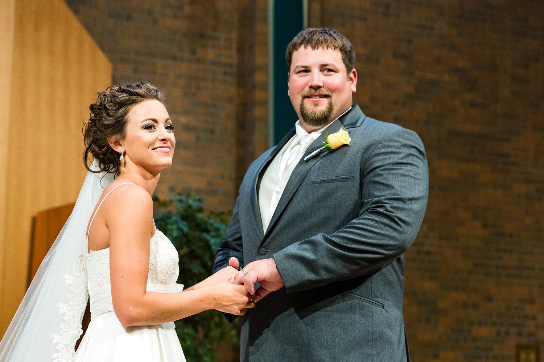 billings-montana-swift-st-thomas-couple-smiling-at-guests.jpg