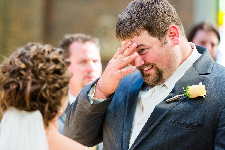 billings-montana-swift-st-thomas-groom-hides-tear.jpg