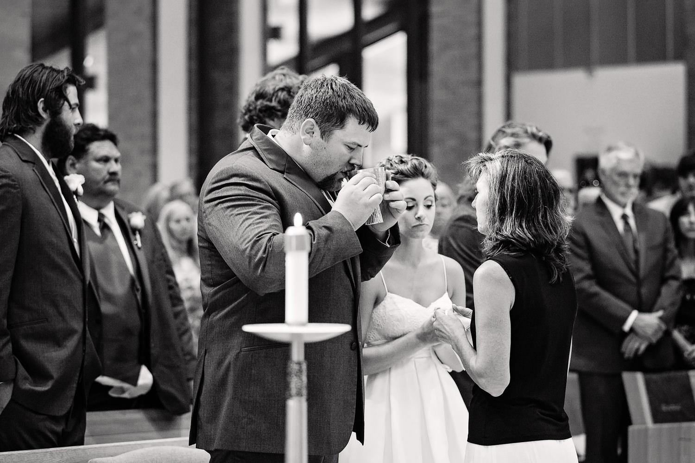 billings-montana-swift-st-thomas-groom-takes-comunion.jpg