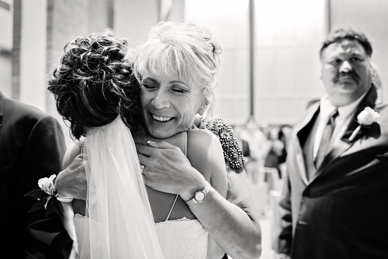 billings-montana-swift-st-thomas-mother-of-groom-hugging-bride.jpg