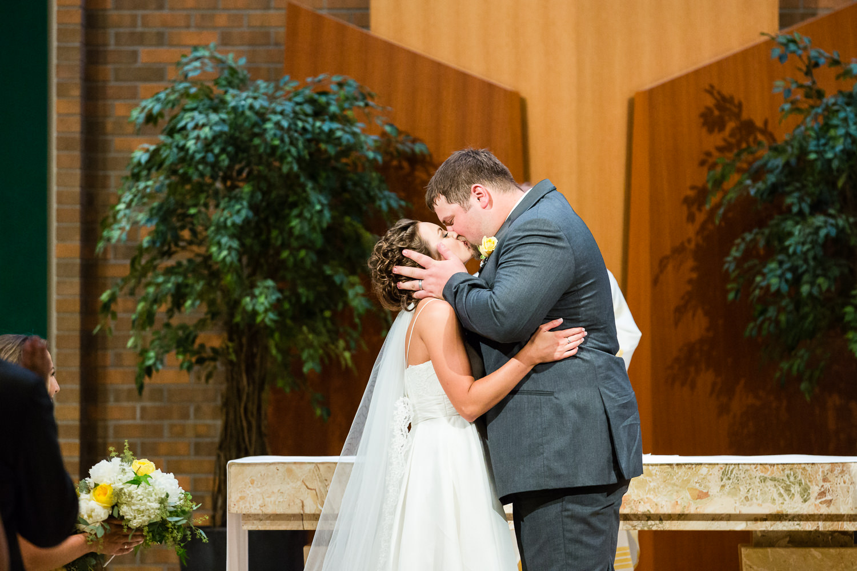 billings-montana-swift-st-thomas-wedding-ceremony-kiss.jpg
