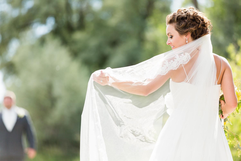 billings-montana-swift-river-ranch-wedding-bride-with-her-veil.jpg