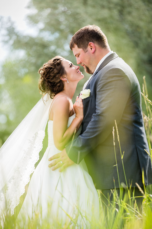 billings-montana-swift-river-ranch-wedding-reception-couple-in-tall-grass.jpg