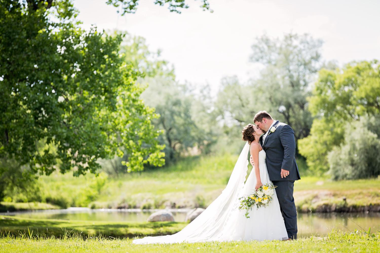 billings-montana-swift-river-ranch-wedding-reception-bride-groom-formal-kissing-in-trees.jpg