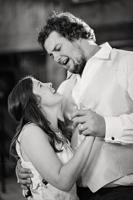 billings-montana-swift-river-ranch-wedding-groomsmen-dancing-with-wife.jpg