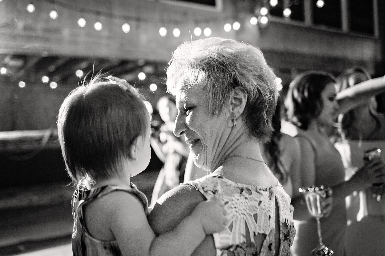 billings-montana-swift-river-ranch-wedding-guest-dancing-with-child.jpg