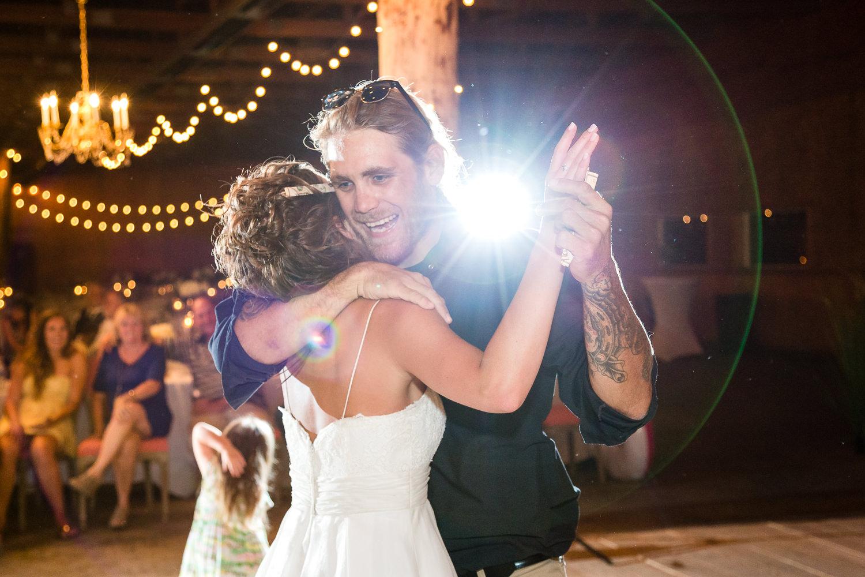 billings-montana-swift-river-ranch-wedding-reception-bride-dances-with-guest.jpg