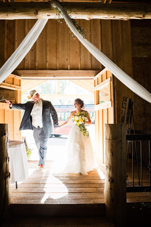 billings-montana-swift-river-ranch-wedding-reception-bride-groom-entry.jpg