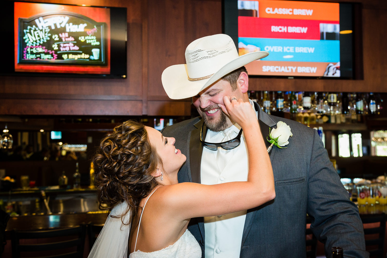 billings-montana-swift-river-ranch-wedding-reception-bride-pinches-grooms-cheek.jpg