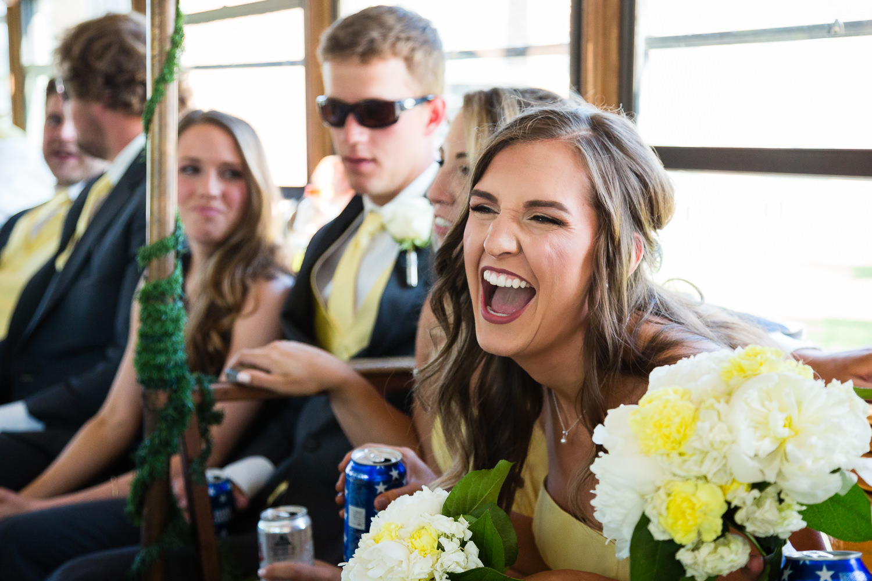 billings-montana-swift-river-ranch-wedding-reception-bridesmaid-laughing-tipsy-trolley.jpg
