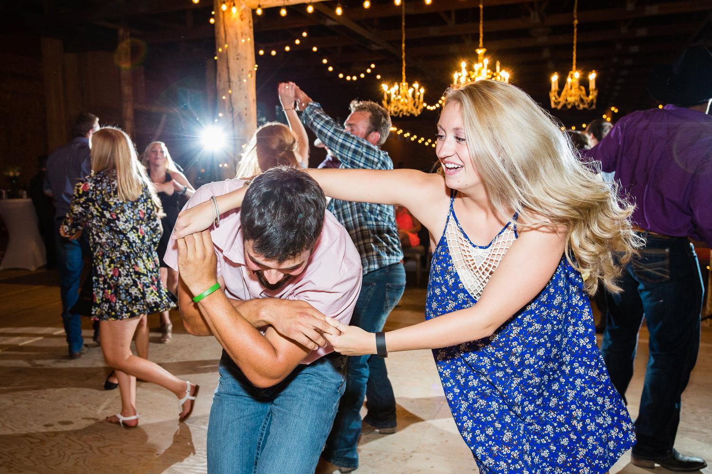 billings-montana-swift-river-ranch-wedding-reception-couple-dancing.jpg