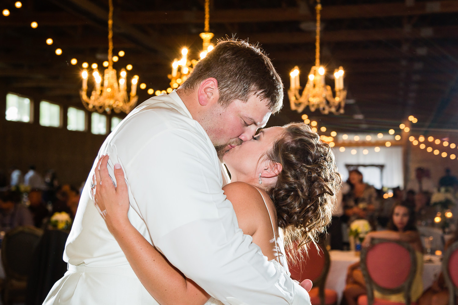billings-montana-swift-river-ranch-wedding-reception-couple-kissing-during-first-dance.jpg
