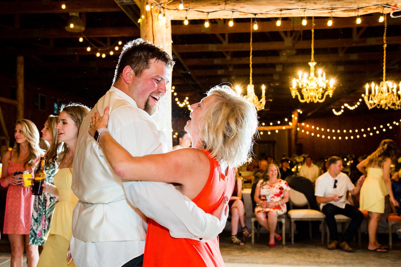 billings-montana-swift-river-ranch-wedding-reception-groom-dances-with-guest.jpg