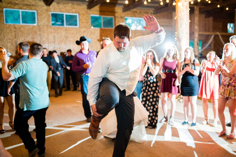 billings-montana-swift-river-ranch-wedding-reception-groom-dancing.jpg