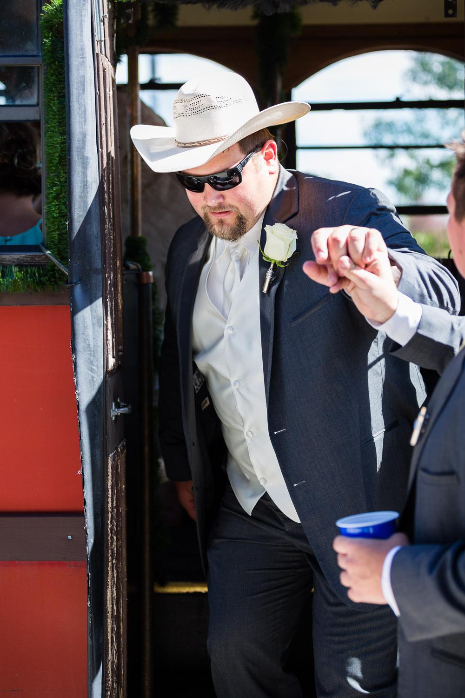 billings-montana-swift-river-ranch-wedding-reception-groom-exits-trolley.jpg