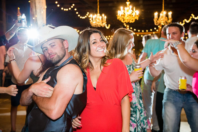 billings-montana-swift-river-ranch-wedding-reception-groomsmen-dances-with-girl.jpg