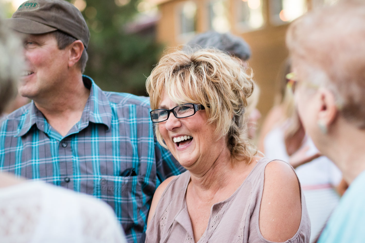 billings-montana-swift-river-ranch-wedding-reception-guests-laughing-outside.jpg