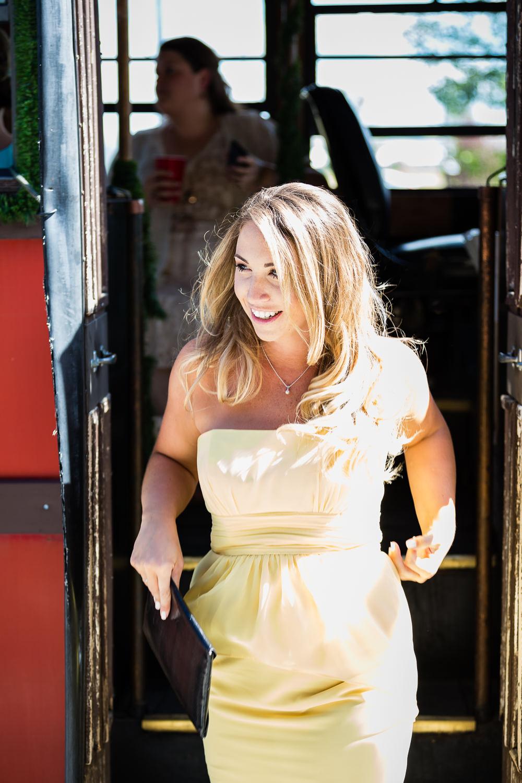 billings-montana-swift-river-ranch-wedding-reception-maid-of-honor-exits-trolley.jpg