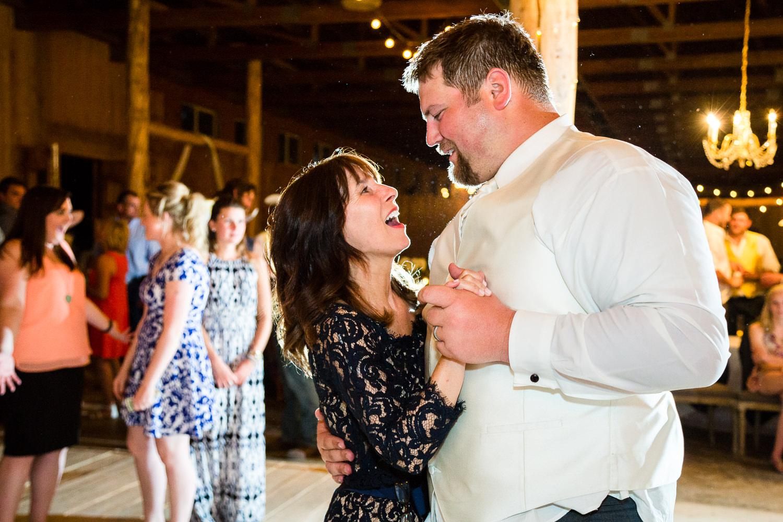 billings-montana-swift-river-ranch-wedding-reception-mother-of-bride-dances-with-groom.jpg