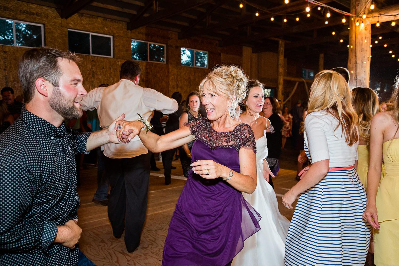 billings-montana-swift-river-ranch-wedding-reception-mother-of-groom-dancing.jpg