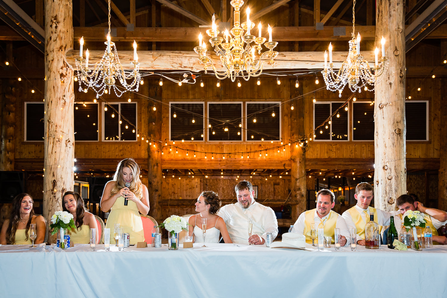 billings-montana-swift-river-ranch-wedding-reception-wedding-party-during-toasts.jpg