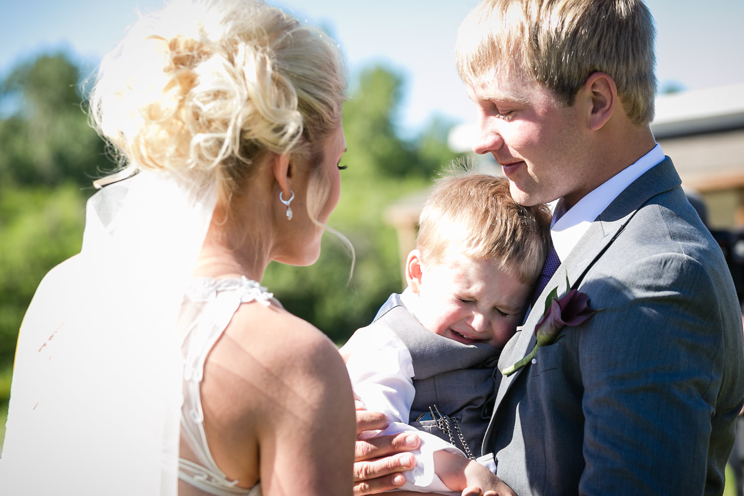 red-lodge-montana-wildflower-wedding-groom-gives-son-watch-during-ceremony.jpg