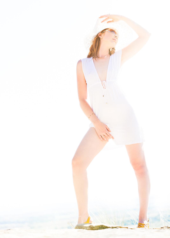 billings-montana-boudoir-photoraphy-woman-poses-on-rims.jpg