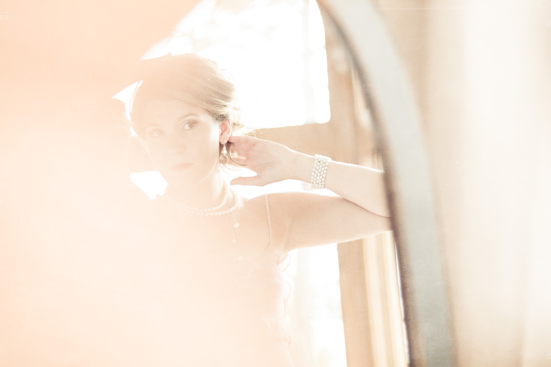 billings-montana-boudoir-photoraphy-woman-preps-herself-mirror.jpg