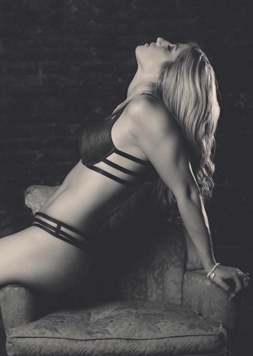 billings-montana-boudoir-photoraphy-woman-stretches-across-chair.jpg