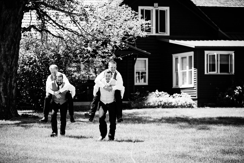 bozeman-montana-wedding-groom-and-groomsmen-piggyback-rides.jpg