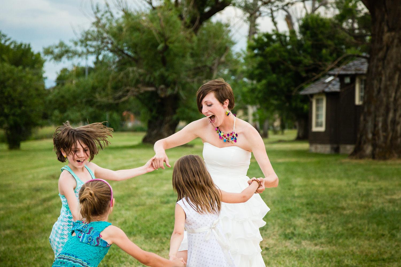 bozeman-montana-wedding-bride-dances-with-girls.jpg