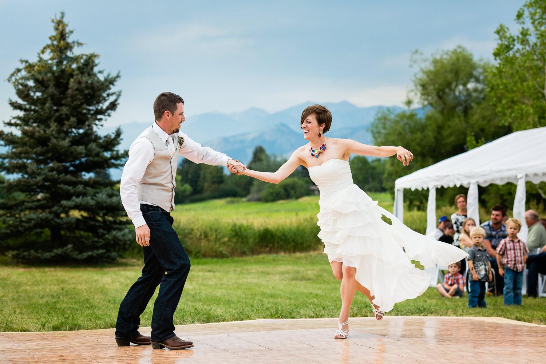 bozeman-montana-wedding-bride-grom-flying-across-dance-floor.jpg