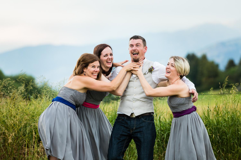 bozeman-montana-wedding-bridesmaids-choke-groom.jpg