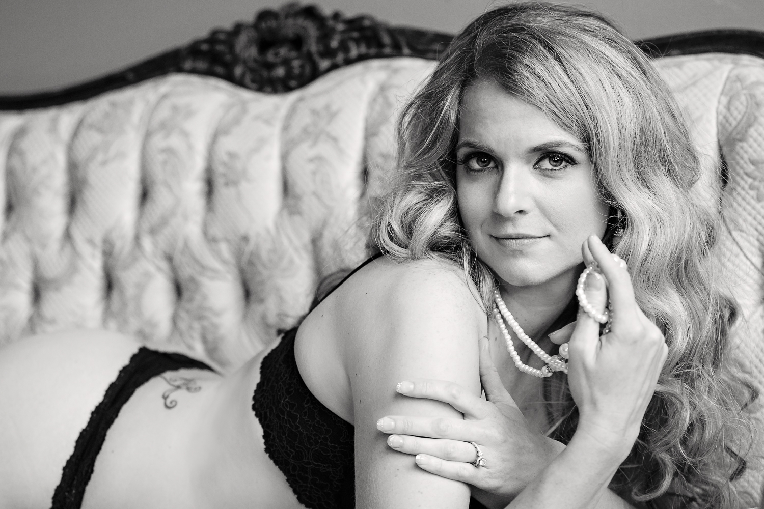 boudoir-photography-billings-mt-woman-lounges-on-chaise.jpg