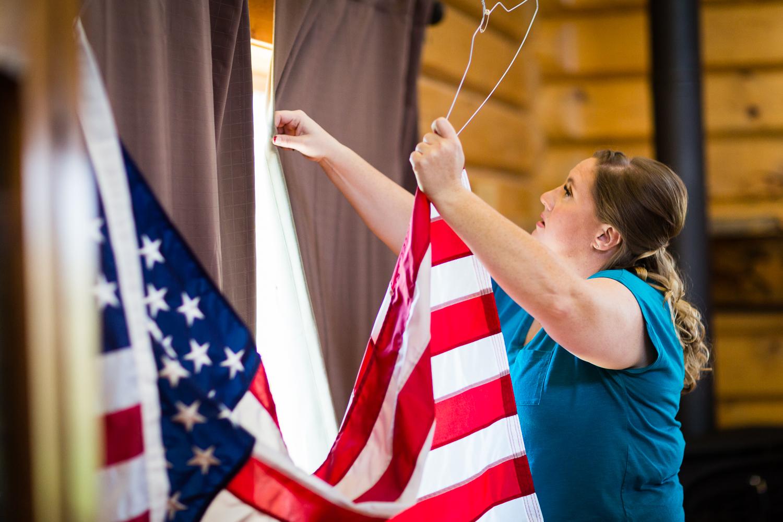 bozeman-montana-wedding-roys-barn-bridesmaid-hangs-flag.jpg