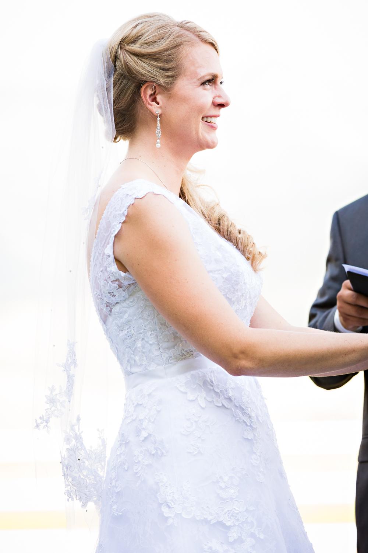 bozeman-montana-wedding-roys-barn-bride-during-ceremony.jpg