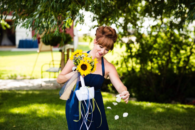 bozeman-montana-wedding-roys-barn-bridesmaid-sprinkles-flower-petals.jpg