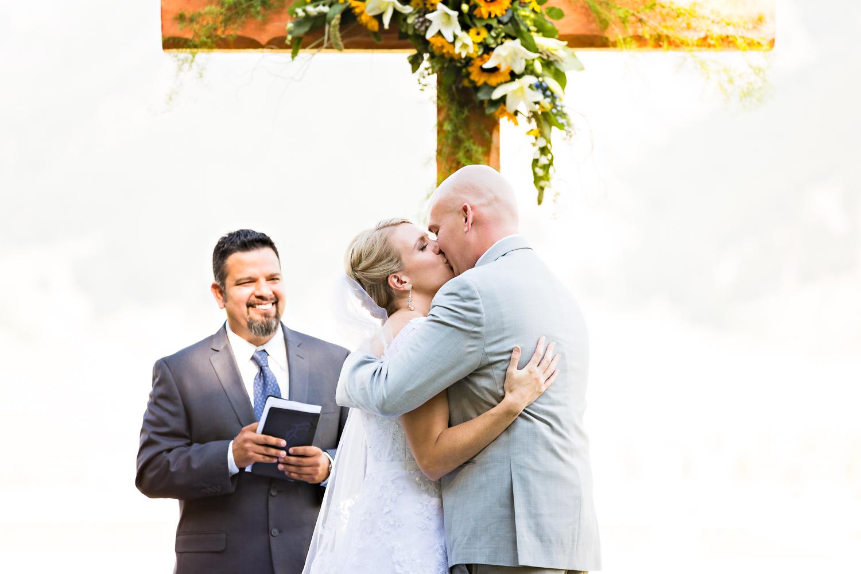 bozeman-montana-wedding-roys-barn-ceremony-kiss.jpg