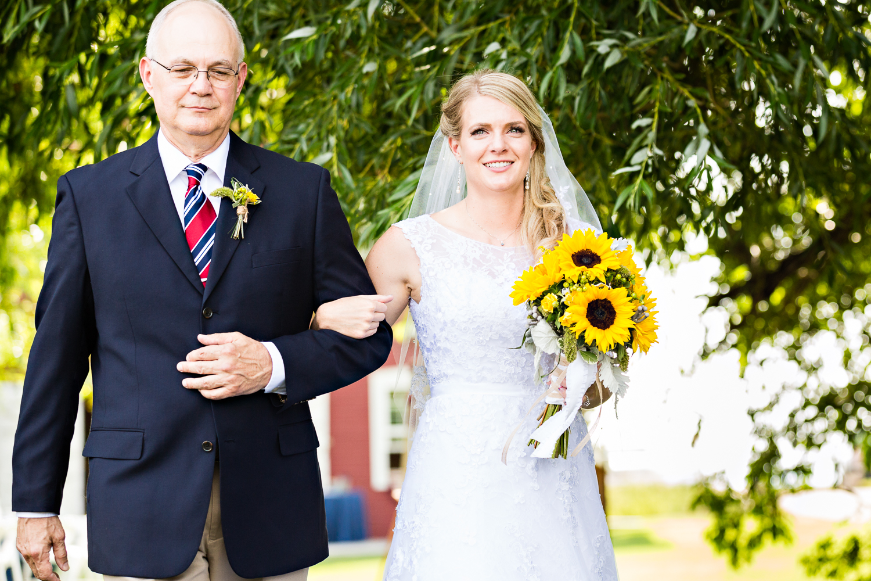 bozeman-montana-wedding-roys-barn-dad-walks-daughter-by tree.jpg