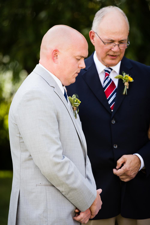 bozeman-montana-wedding-roys-barn-groom-prays-during-ceremony.jpg